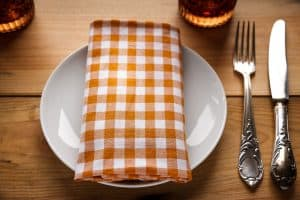 A table setting with napkin on the plate is something that kids can do to help with chores