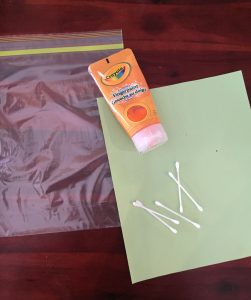 Paint, paper and plastic bag to paint in a bag. A clean way to paint and build fine motor skills.