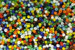 A group of small beads can be used to build fine motor skills