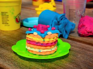 Colorful play dough is a way to build fine motor skills