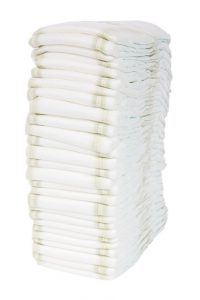 How to Deal with a Milk Allergy in Babies. Stack of diapers.