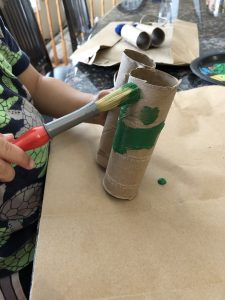 Painting toilet paper rolls for finding a leprechaun