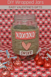 Wrapped jar with candy on the side for a valentines craft for kids