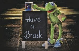 Kermit standing next to a sign that say Have a break is a simple reminder to get through the Holiday craziness and enjoy it.