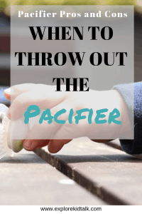 Baby grabbing a pacifier. Learn when to throw out the pacifier