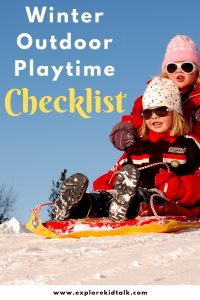 Enjoy winter outdoor playtime being on a sled. Two girls in snow jackets on a sled.